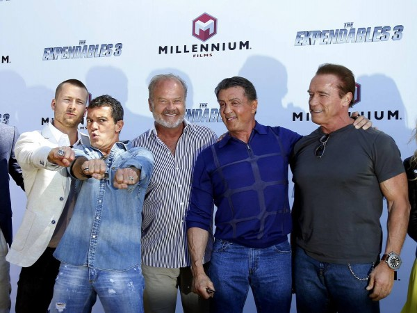 """Cast members Glen Powell , Antonio Banderas, Kelsey Grammer, Sylvester Stallone andArnold Schwarzenegger pose during a photocall on the Croisette to promote the film """"The Expendables 3"""" during the 67th Cannes Film Festival in Cannes"""