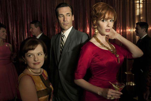 L-R) Peggy Olson (Elisabeth Moss), Don Draper (Jon Hamm) and Joan Harris (Christina Hendricks) in Mad Men