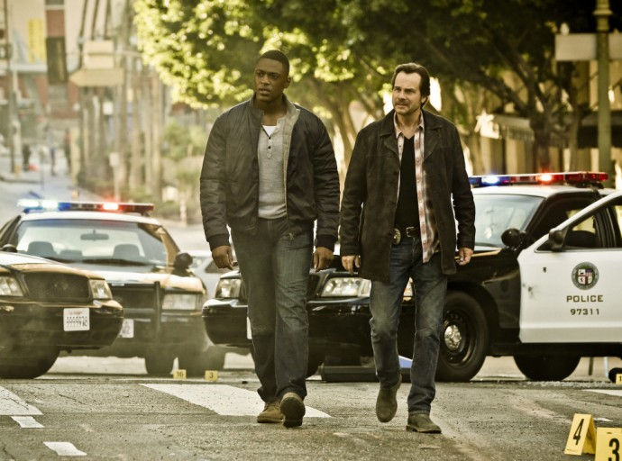TRAINING DAY is a crime thriller that begins 15 years after the events of the feature film, about a young, idealistic police officer (Justin Cornell, left) who is tapped to go undercover in an elite squad of the LAPD where he partners with a veteran, morally ambiguous detective (Bill Paxton). Photo: Michael Yarish/CBS ©2016 CBS Broadcasting, Inc. All Rights Reserved