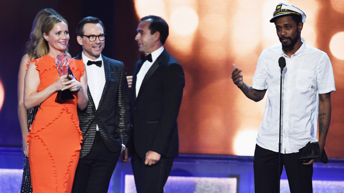 SANTA MONICA, CA - DECEMBER 11:  Actor Keith Stanfield (R) crashes the stage with actors Leslie Mann (L) and Christian Slater (2nd L) and producer Tom Lassally (3rd L), winner of Best Comedy Series for 'Silicon Valley,' during the 22nd Annual Critics' Choice Awards at Barker Hangar on December 11, 2016 in Santa Monica, California.  (Photo by Ethan Miller/Getty Images)
