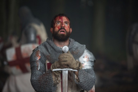 tom_cullen_as_landry_bowed_before_his_sword_in_historys_new_drama_series_knightfall