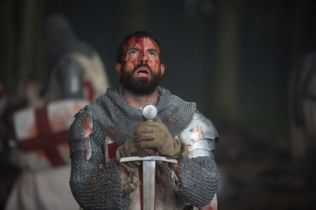 tom_cullen_as_landry_bowed_before_his_sword_in_historys_new_drama_series_knightfall-690x460